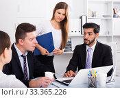 Купить «Business colleagues at joint meeting», фото № 33365226, снято 25 мая 2020 г. (c) Яков Филимонов / Фотобанк Лори
