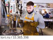Купить «Portrait of professional man working with stainless steel», фото № 33365398, снято 4 февраля 2020 г. (c) Яков Филимонов / Фотобанк Лори
