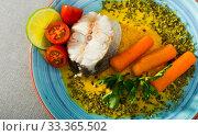 Steamed hake served with vegetable pate, carrots, lemon, greens and tomatoes. Стоковое фото, фотограф Яков Филимонов / Фотобанк Лори