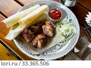 Купить «Oriental grilled pork meat shashlik», фото № 33365506, снято 4 июня 2020 г. (c) Яков Филимонов / Фотобанк Лори
