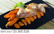 Купить «Tasty quail of teriyaki with carrots, fried on a grill, served with greens», фото № 33365526, снято 9 апреля 2020 г. (c) Яков Филимонов / Фотобанк Лори
