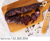 Купить «French tasty meal dry-cured sausage with liver at wooden desk», фото № 33365554, снято 4 апреля 2020 г. (c) Яков Филимонов / Фотобанк Лори