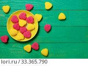 Купить «Разноцветный мармелад. Желтый и красный мармелад в блюдце на зеленом деревянном столе. Вид сверху. Свободное место», фото № 33365790, снято 11 марта 2020 г. (c) ирина реброва / Фотобанк Лори