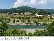 Купить «Rural landscape with mountains and houses in Zabljak Municipality, Montenegro», фото № 33366094, снято 14 июня 2019 г. (c) Володина Ольга / Фотобанк Лори