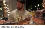 Купить «happy friends having christmas dinner at home», видеоролик № 33366162, снято 9 февраля 2020 г. (c) Syda Productions / Фотобанк Лори