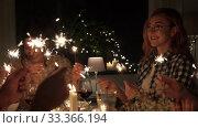 Купить «happy friends having christmas dinner at home», видеоролик № 33366194, снято 9 февраля 2020 г. (c) Syda Productions / Фотобанк Лори