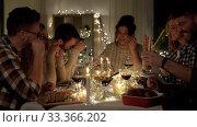 Купить «happy friends drinking red wine at christmas party», видеоролик № 33366202, снято 9 февраля 2020 г. (c) Syda Productions / Фотобанк Лори