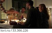 Купить «happy friends with red wine at christmas party», видеоролик № 33366226, снято 9 февраля 2020 г. (c) Syda Productions / Фотобанк Лори