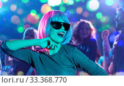 woman in pink wig and sunglasses dancing at party. Стоковое фото, фотограф Syda Productions / Фотобанк Лори