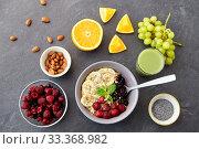 Купить «cereal with berries, fruits and glass of juice», фото № 33368982, снято 1 ноября 2018 г. (c) Syda Productions / Фотобанк Лори