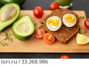 toast bread with eggs, cherry tomatoes and avocado. Стоковое фото, фотограф Syda Productions / Фотобанк Лори