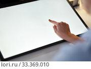 Купить «hand on led light tablet at night office», фото № 33369010, снято 24 января 2019 г. (c) Syda Productions / Фотобанк Лори