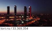 Купить «Night view of the four towers (Cuatro Torres) of the business district in Madrid. Spain», видеоролик № 33369354, снято 6 июля 2020 г. (c) Яков Филимонов / Фотобанк Лори