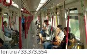 Купить «Passengers in a train in Hong Kong», видеоролик № 33373554, снято 7 ноября 2019 г. (c) Игорь Жоров / Фотобанк Лори