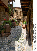 Купить «The narrow stone paved street of the old Kakopetria. Nicosia District. Cyprus», фото № 33373670, снято 11 июня 2018 г. (c) Serg Zastavkin / Фотобанк Лори
