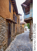 Купить «The narrow mediaeval street of old Kakopetria. Nicosia District. Cyprus», фото № 33373682, снято 11 июня 2018 г. (c) Serg Zastavkin / Фотобанк Лори