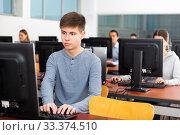 Купить «Portrait of students at computers in university», фото № 33374510, снято 20 мая 2020 г. (c) Яков Филимонов / Фотобанк Лори