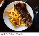 Купить «Tasty veal kebab and french fries served at plate», фото № 33374726, снято 3 апреля 2020 г. (c) Яков Филимонов / Фотобанк Лори