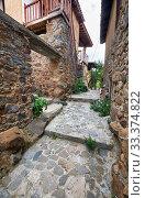 Купить «The narrow mediaeval street of old Kakopetria. Nicosia District. Cyprus», фото № 33374822, снято 11 июня 2018 г. (c) Serg Zastavkin / Фотобанк Лори