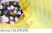 Яркий весенний букет с тюльпанами и ирисами на желтой ткани. Место для текста. Стоковое фото, фотограф Наталья Гармашева / Фотобанк Лори