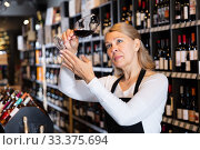 Купить «Woman wine producer inspecting quality of wine», фото № 33375694, снято 6 июля 2020 г. (c) Яков Филимонов / Фотобанк Лори