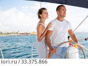 Купить «Couple steering yacht along Spanish coast», фото № 33375866, снято 6 апреля 2020 г. (c) Яков Филимонов / Фотобанк Лори