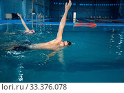 Купить «Male swimmer swims in the pool», фото № 33376078, снято 19 февраля 2020 г. (c) Tryapitsyn Sergiy / Фотобанк Лори