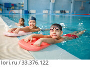 Children swimming group poses at the poolside. Стоковое фото, фотограф Tryapitsyn Sergiy / Фотобанк Лори