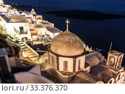 The view on Fira town and the Orthodox Church of St. John top view at night, Santorini, Greece (2017 год). Редакционное фото, фотограф Наталья Волкова / Фотобанк Лори