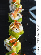 Купить «Japanese seafood sushi set», фото № 33376518, снято 11 марта 2020 г. (c) Jan Jack Russo Media / Фотобанк Лори