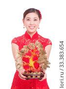 Купить «Young asian woman in red cheongsam holds lucky tree in chinese new year», фото № 33383654, снято 14 июля 2020 г. (c) age Fotostock / Фотобанк Лори