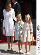 King Felipe VI of Spain, Queen Letizia of Spain, Princess of Asturias, Leonor, and Princess Sofia attends a Military Parade at the Congress for the crowing... (2014 год). Редакционное фото, фотограф Manuel Cedron / age Fotostock / Фотобанк Лори