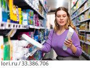 Купить «Portrait of attentive woman choosing cotton pads», фото № 33386706, снято 31 марта 2020 г. (c) Яков Филимонов / Фотобанк Лори