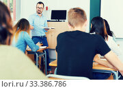 Купить «Man teacher giving lecture in classroom», фото № 33386786, снято 25 мая 2018 г. (c) Яков Филимонов / Фотобанк Лори