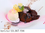 Chocolate flan with vanilla ice cream on a white plate. Стоковое фото, фотограф Марина Володько / Фотобанк Лори