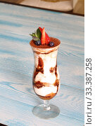 Купить «Tiramisu with strawberries, blueberries and mint», фото № 33387258, снято 12 февраля 2019 г. (c) Марина Володько / Фотобанк Лори