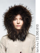 Купить «Portrait of a young female in a winter coat with fur trimmed hood.», фото № 33390810, снято 11 января 2020 г. (c) Serg Zastavkin / Фотобанк Лори