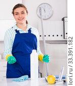 Купить «Female cleaner is ready to clean the cabinet», фото № 33391182, снято 21 мая 2017 г. (c) Яков Филимонов / Фотобанк Лори