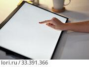 Купить «hand on led light tablet at night office», фото № 33391366, снято 24 января 2019 г. (c) Syda Productions / Фотобанк Лори