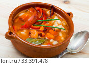 Купить «Soup of bean with boiled carrots, pepper and greens, served in bowl», фото № 33391478, снято 5 июля 2020 г. (c) Яков Филимонов / Фотобанк Лори