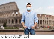 Купить «man wearing protective medical mask in italy», фото № 33391534, снято 15 марта 2014 г. (c) Syda Productions / Фотобанк Лори