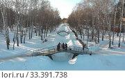 Russian folklore - five people in russian costumes are dancing on the bridge in winter park. Стоковое видео, видеограф Константин Шишкин / Фотобанк Лори