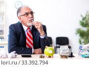 Купить «Old male accountant in budget planning concept», фото № 33392794, снято 12 сентября 2019 г. (c) Elnur / Фотобанк Лори