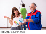 Купить «Young couple and old contractor in home renovation concept», фото № 33394978, снято 2 сентября 2019 г. (c) Elnur / Фотобанк Лори