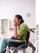 Купить «Young male invalid in wheel-chair suffering at home», фото № 33396086, снято 23 июля 2019 г. (c) Elnur / Фотобанк Лори