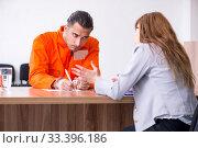 Купить «Young man meeting with advocate in pre-trial detention», фото № 33396186, снято 20 мая 2019 г. (c) Elnur / Фотобанк Лори