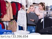 Ordinary girl looking for clothing with mum. Стоковое фото, фотограф Яков Филимонов / Фотобанк Лори