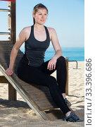 Купить «Woman resting after training on beach», фото № 33396686, снято 8 мая 2017 г. (c) Яков Филимонов / Фотобанк Лори