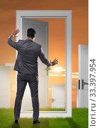 The businessman facing many business opportunities. Стоковое фото, фотограф Elnur / Фотобанк Лори