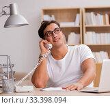 Купить «Young man working in the office», фото № 33398094, снято 19 октября 2016 г. (c) Elnur / Фотобанк Лори